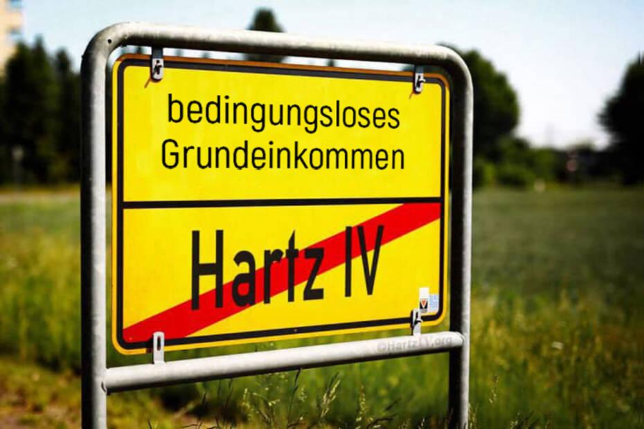 Ortschild Hartz IV durchgestrichen Richtung Bedingungsloses Grundeinkommen