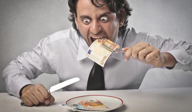Geschäftsmann isst Geld